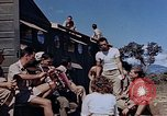 Image of Airmen of the 65th Fighter Squadron having some fun France, 1944, second 9 stock footage video 65675049830