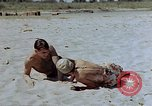 Image of Lt. Col Gilbert O. Wymond and airmen of the 65th Fighter Squadron Corsica France, 1944, second 9 stock footage video 65675049831
