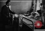 Image of Adolf Hitler visits July 20th bomb plot victims in hospital Rastenburg Germany, 1944, second 9 stock footage video 65675049858