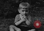 Image of small boy Kentucky United States USA, 1940, second 3 stock footage video 65675050014