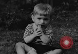 Image of small boy Kentucky United States USA, 1940, second 7 stock footage video 65675050014