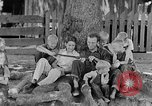 Image of man under a tree Kentucky United States USA, 1940, second 1 stock footage video 65675050028