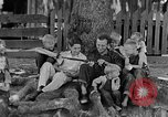 Image of man under a tree Kentucky United States USA, 1940, second 2 stock footage video 65675050028
