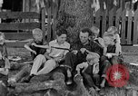Image of man under a tree Kentucky United States USA, 1940, second 3 stock footage video 65675050028