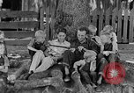 Image of man under a tree Kentucky United States USA, 1940, second 4 stock footage video 65675050028