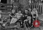 Image of man under a tree Kentucky United States USA, 1940, second 5 stock footage video 65675050028