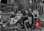 Image of man under a tree Kentucky United States USA, 1940, second 7 stock footage video 65675050028