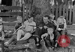 Image of man under a tree Kentucky United States USA, 1940, second 8 stock footage video 65675050028