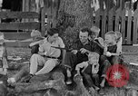 Image of man under a tree Kentucky United States USA, 1940, second 9 stock footage video 65675050028