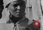 Image of Negro woman in rural Alabama Calhoun Alabama USA, 1940, second 7 stock footage video 65675050040