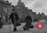 Image of old couple La Haye Du Puits France, 1944, second 7 stock footage video 65675050171