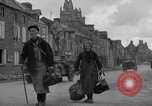 Image of old couple La Haye Du Puits France, 1944, second 8 stock footage video 65675050171