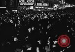 Image of Crowds celebrate on election night in Times Square New York City USA, 1940, second 4 stock footage video 65675050195