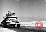 Image of British soldiers retrieve a disabled tank while being shelled North Africa, 1941, second 7 stock footage video 65675050209