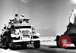 Image of British soldiers retrieve a disabled tank while being shelled North Africa, 1941, second 8 stock footage video 65675050209
