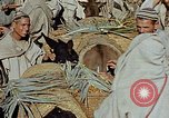 Image of snake charmer Marrakesh Morocco, 1942, second 4 stock footage video 65675050221