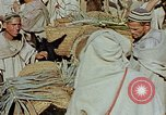 Image of snake charmer Marrakesh Morocco, 1942, second 9 stock footage video 65675050221