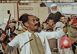 Image of street magician Marrakesh Morocco, 1942, second 1 stock footage video 65675050222