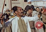 Image of street magician Marrakesh Morocco, 1942, second 3 stock footage video 65675050222