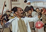 Image of street magician Marrakesh Morocco, 1942, second 4 stock footage video 65675050222