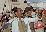 Image of street magician Marrakesh Morocco, 1942, second 5 stock footage video 65675050222