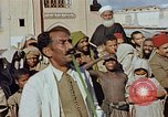 Image of street magician Marrakesh Morocco, 1942, second 6 stock footage video 65675050222