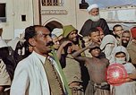 Image of street magician Marrakesh Morocco, 1942, second 7 stock footage video 65675050222