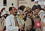 Image of street magician Marrakesh Morocco, 1942, second 8 stock footage video 65675050222