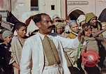 Image of street magician Marrakesh Morocco, 1942, second 9 stock footage video 65675050222