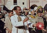 Image of street magician Marrakesh Morocco, 1942, second 10 stock footage video 65675050222
