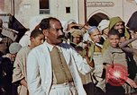 Image of street magician Marrakesh Morocco, 1942, second 11 stock footage video 65675050222