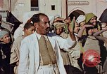 Image of street magician Marrakesh Morocco, 1942, second 12 stock footage video 65675050222