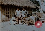Image of application of war paint Southeast Asia, 1942, second 3 stock footage video 65675050280