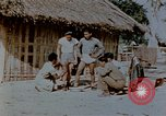 Image of application of war paint Southeast Asia, 1942, second 4 stock footage video 65675050280