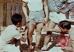 Image of application of war paint Southeast Asia, 1942, second 5 stock footage video 65675050280
