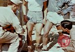 Image of application of war paint Southeast Asia, 1942, second 8 stock footage video 65675050280