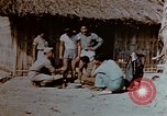Image of application of war paint Southeast Asia, 1942, second 10 stock footage video 65675050280