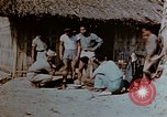 Image of application of war paint Southeast Asia, 1942, second 11 stock footage video 65675050280