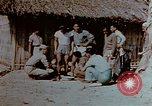 Image of application of war paint Southeast Asia, 1942, second 12 stock footage video 65675050280
