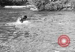 Image of fish catching dog Washington State United States USA, 1929, second 7 stock footage video 65675050359