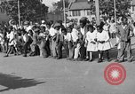 Image of Water melon eating contest Oakland California USA, 1929, second 2 stock footage video 65675050360