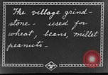 Image of village grindstone China, 1938, second 2 stock footage video 65675050387