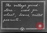 Image of village grindstone China, 1938, second 4 stock footage video 65675050387