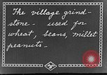 Image of village grindstone China, 1938, second 5 stock footage video 65675050387