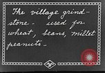 Image of village grindstone China, 1938, second 6 stock footage video 65675050387