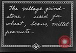 Image of village grindstone China, 1938, second 7 stock footage video 65675050387