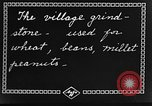 Image of village grindstone China, 1938, second 8 stock footage video 65675050387