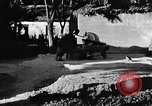 Image of village grindstone China, 1938, second 12 stock footage video 65675050387