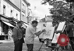 Image of painter Paris France, 1956, second 12 stock footage video 65675050420
