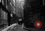 Image of backstreet alley Paris France, 1956, second 7 stock footage video 65675050427